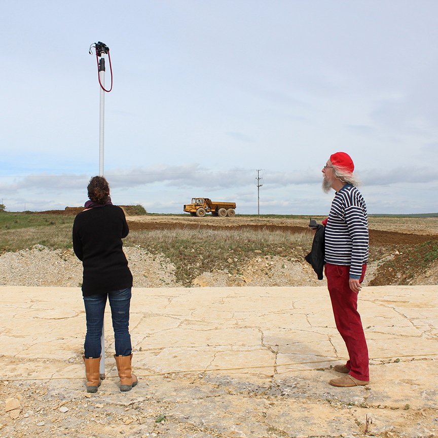 Photographing the footprints using a remote controlled camera and photo-pole